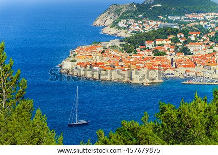 Old Town of Dubrovnik and luxurious yacht, Croatia, Europe. City on Adriatic Sea, Dalmatia, one of most prominent tourist Mediterranean Sea destinations, seaport and centre of Dubrovnik-Neretva County - stock photo