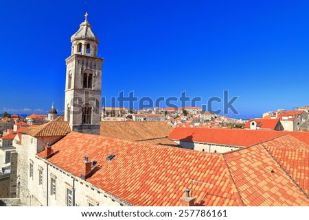 Old town of Dubrovnik with church tower above orange roof tops, Croatia - stock photo
