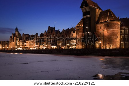 Old Town of Gdansk (Danzig) Poland Europe with Motlawa river and the Crane (Polish: Zuraw) symbol of Danzig. Winter night scenery - stock photo