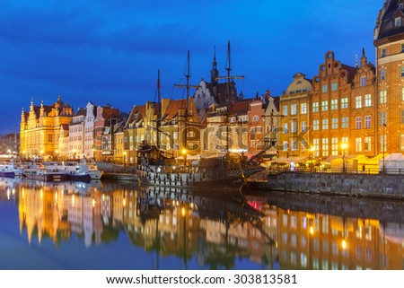 Old Town of Gdansk, Dlugie Pobrzeze and Motlawa River at night, Poland - stock photo