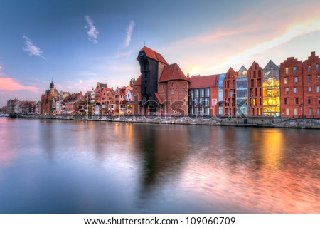 Old town of Gdansk with ancient crane at dusk, Poland - stock photo