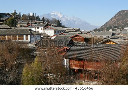 Old town of Lijiang and snow mountain - stock photo