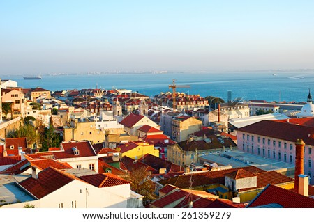 Old Town of Lisbon at sunset. Aerial view - stock photo