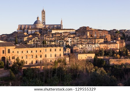 Old town of medieval Siena at sunset. - stock photo