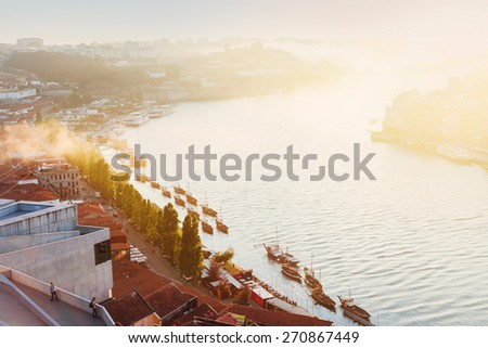 old town of Porto and river Douro with soft light of  sunset, Portugal - stock photo