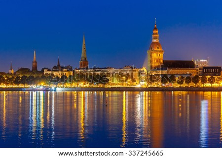 Old Town of Riga and River Daugava at night, Riga Cathedral, Cathedral Basilica of Saint James and Riga castle in the background, Latvia - stock photo