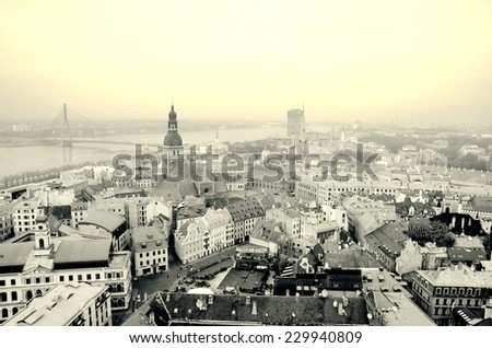 Old Town of Riga (Latvia) in the cloudy day.  Daugava river. The panoramic view from the tower St.Peter's Church. With retro vintage Instagram  filter  - stock photo