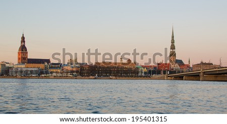 Old Town of Riga (Latvia)  in the evening.  The view from Daugava river - stock photo