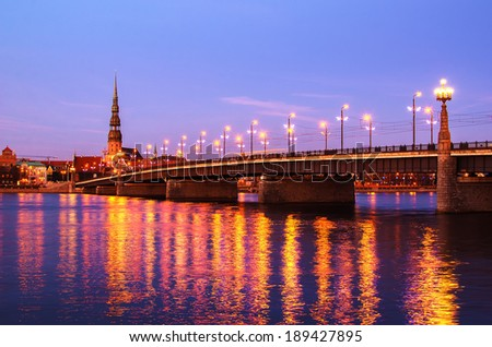 Old Town of Riga (Latvia)  in the evening.  The view from Daugava river. One of the most beautiful touristic destinations in Eastern and Central Europe.  - stock photo