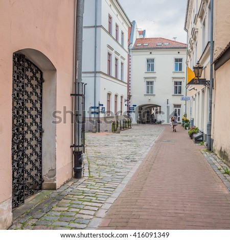 Old Town of Riga (Vecriga), Latvia-October 2, 2015: Early morning views of restored, preserved, colorful buildings,cobbled, winding narrow streets, shops, restaurants, museums, rooftops