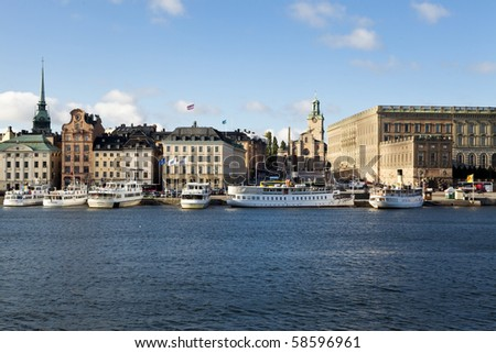 Old town of Stockholm from the water. Royal Castle to the right. - stock photo