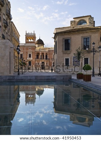 Old town of Valencai (Spain). Buildings of the historic city reflected on the water of a fountain. - stock photo