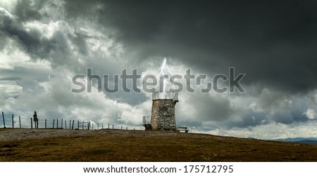 Old town on the mountain,sky with lightning,storm - stock photo