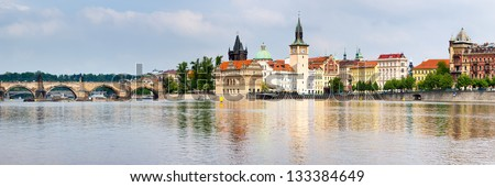 Old Town reflected in the River Vltava shot from Strelecky Ostrov Island Prague - stock photo