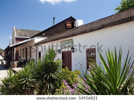 Old Town San Diego showing old restaurant behind cactus garden - stock photo