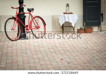 Old town scene with vintage red bicycle parked near street light in Buda part of Budapest city, Hungary, Europe. Famous travel destination. - stock photo