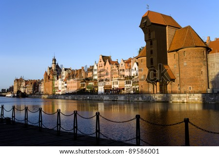 Old Town skyline along the river Motlawa in Gdansk, Poland, on the right side of the image The Crane (Polish: Zuraw).