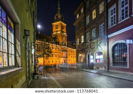 Old Town street at night with view to Royal Palace in Warsaw, Poland - stock photo