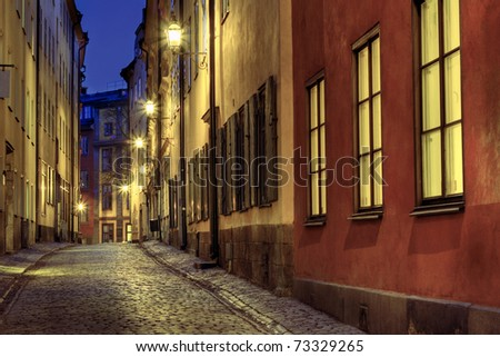 Old Town street illuminated at night. - stock photo