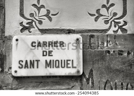 Old town street in Barcelona - Carrer de Sant Miquel. Street sign. Black and white tone. - stock photo
