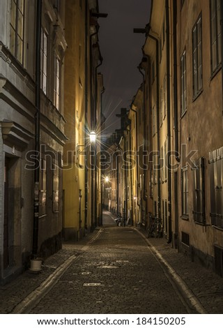 Old town street in Stockholm Sweden at night.