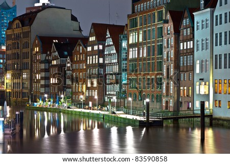old townhouses at the canal in Hamburg by night - stock photo