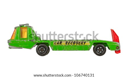 Old toy car (buggy car recovery, 1970) isolated on white - stock photo
