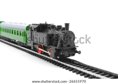 Old toy railroad train arriving - stock photo