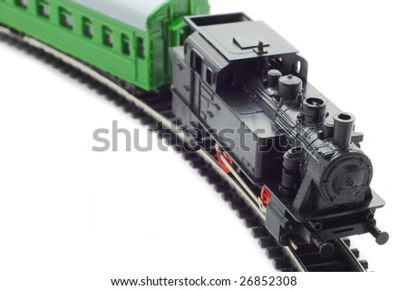 Old toy railroad train isolated on white - stock photo