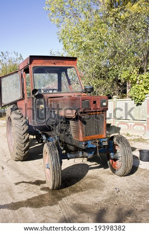 old tractor being ready to be used - stock photo