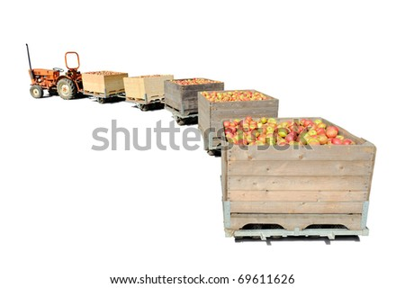 Old tractor carrying wooden crates full of fresh apples. Isolated over white - stock photo