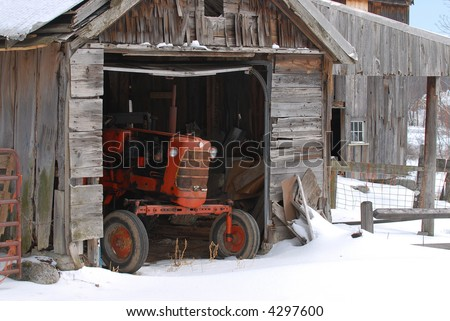 Old tractor in Barn - stock photo