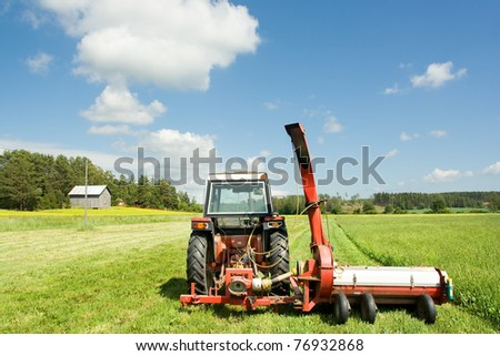 Old tractor in countryside - stock photo