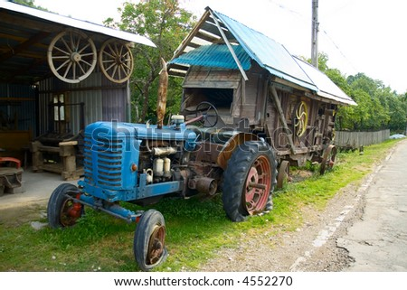 Old tractor with mobile mill