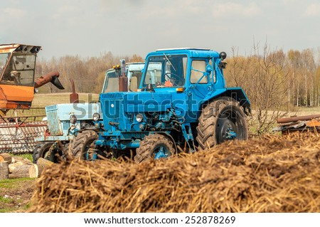 Old tractors on a farm in Latvia - stock photo