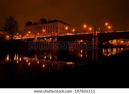 Old traditional arch bridge in the dark - stock photo