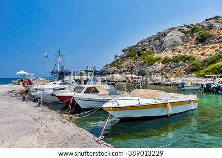 Old traditional beautiful fishing boats by the sea in Rhodes island in Greece - stock photo