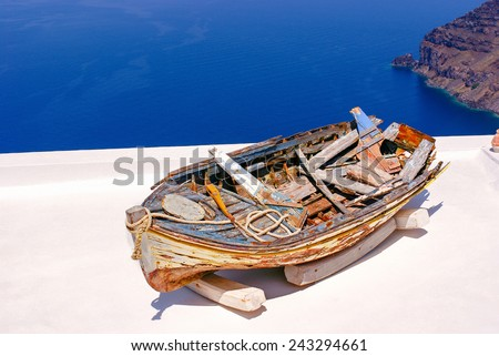 Old traditional boat on terrace, Santorini island, Greece - stock photo