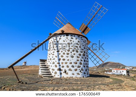 Old traditional built in canary style windmill in Llanos de la Conception village, Fuerteventura, Canary Islands, Spain - stock photo