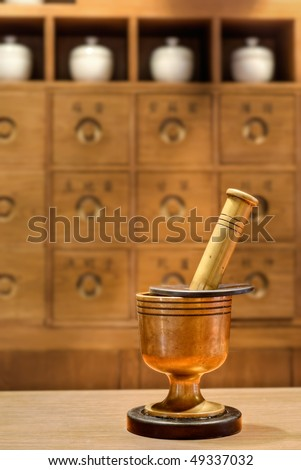 Old traditional Chinese medicine tool in pharmacy. - stock photo