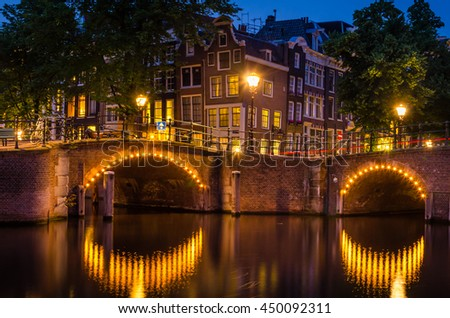 Old Traditional Dutch Houses and Brick Bridges in Amsterdam at Night