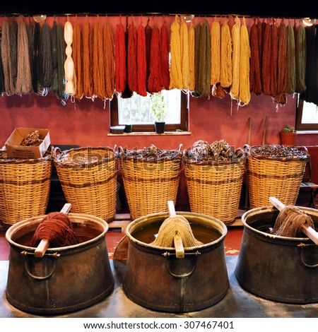 Old traditional dyeing yarn for carpets - stock photo