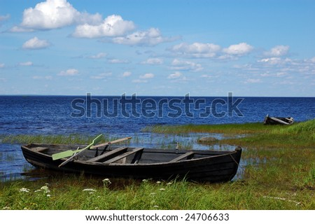 Old boat green river shore stock photo 15123925 shutterstock for Bank fishing near me