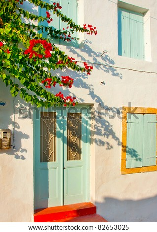Old traditional  house with green  windows in Kithira island Greece - stock photo