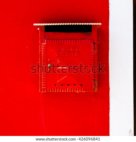 Old traditional post box on the old wall - stock photo