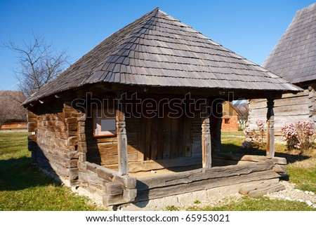 Old traditional Romanian barn or shack under blue sky - this is part of a series of images with countryside buildings in Romania