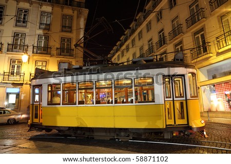 Old traditional tram in the city of Lisbon at night, Portugal