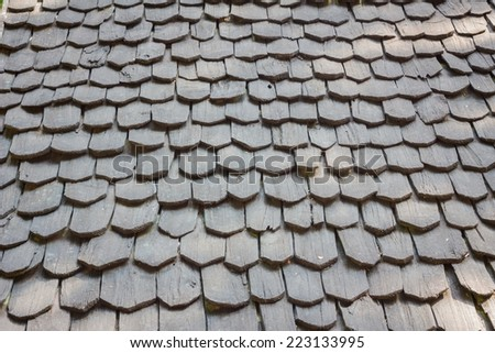 old traditional wooden roof tile of old house. - stock photo