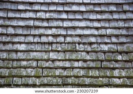 Old traditional wooden tiled roof.  - stock photo