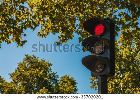 Old traffic lights in city close-up. - stock photo